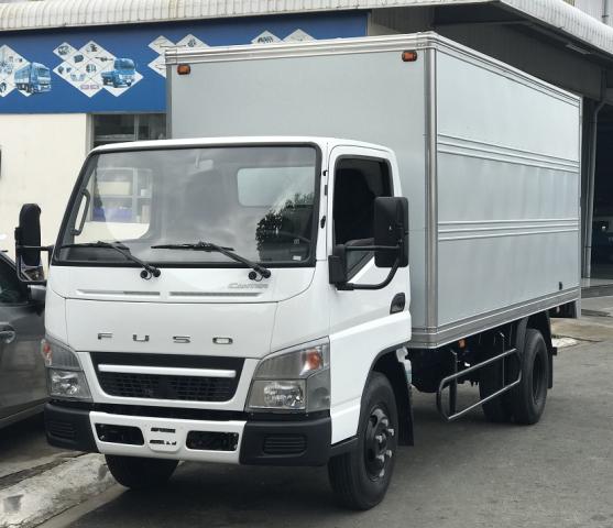 xe-tai-fuso-499-thung-kin-2t5.png